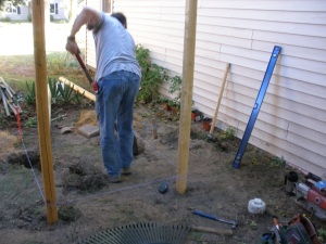 Digging in the posts for the foundation.