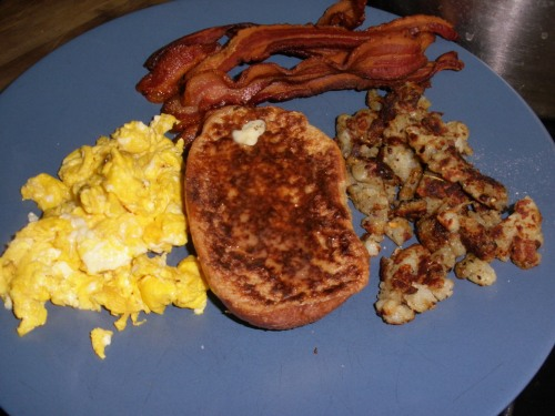 Scrambled eggs, hash browns, French Toast and bacon.