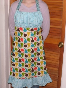 Gwen modeling the apron.
